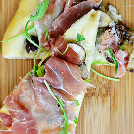 Prosciutto, mushroom and truffle oil pizza