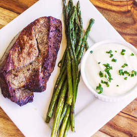 Broiled Steak & Asparagus with Feta Cream Sauce